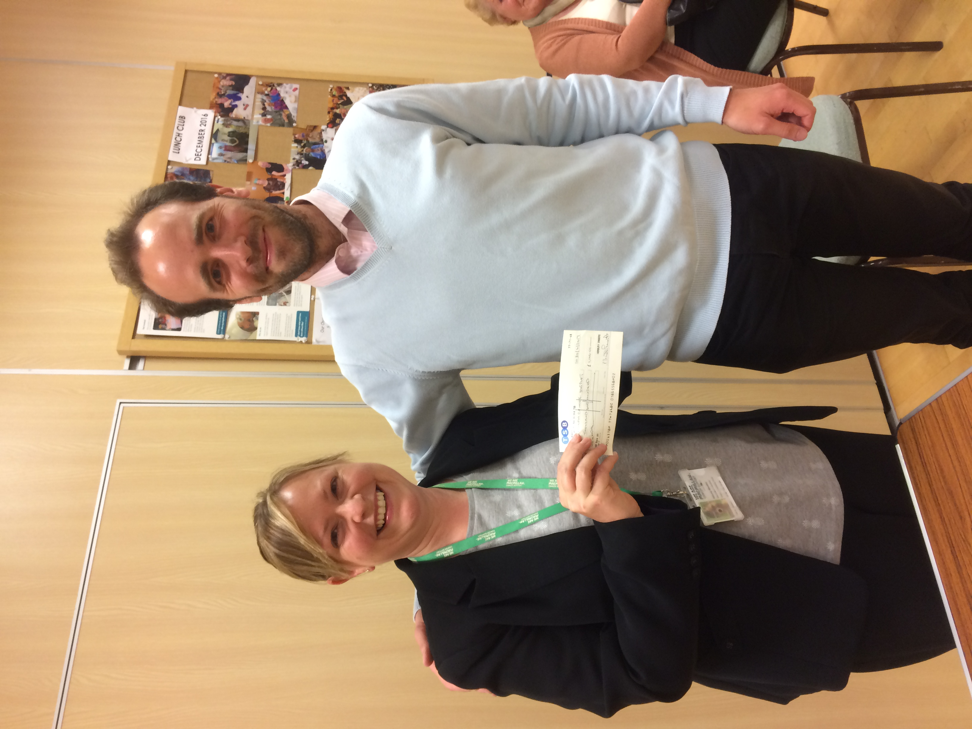 Edward Whelan, Horbury Singers Musical Director presents cheque for £1100 to Stacey Rhodes for the Macmillan Nurses Fund.